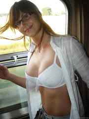 Wife stripping off on a train showing her lovely natural breasts