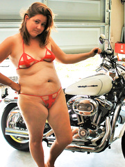 Chubby horny wife poses with her harley for pictures