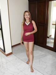 Latti in red dress photographed in Thailand