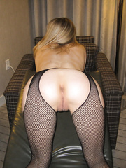 Young Amateur MILF Katrina in Fishnets spreads pussy