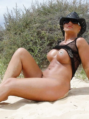 sexy FRENCH MILF posing for topless and full nude photos outdoors