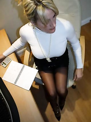 Busty Milf wearing black stockings in the office