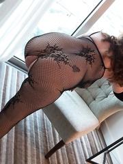 Sexy milf Teacher wearing fishnet body stocking
