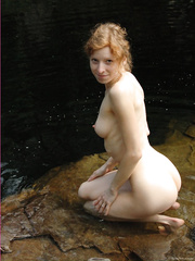 Outdoor exhibitionist showing off her naked body in the mountains