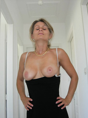 Horny milf exposing her tit s and pussy with lovely creamy cum shot