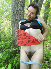 Posing in the woods wearing pants and a brassiere