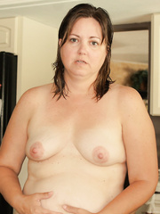 Fat wife shows off diminutive pants and cookie
