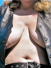 Large somewhat saggy Milk Sacks outdoors in public