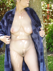 This Babe posed by the tree outside in just her robe