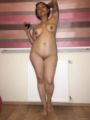 My wife with a nice wine posing nude on the sofa