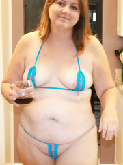 Corpulent wife shows off in her petite bikini then receives in nature's garb