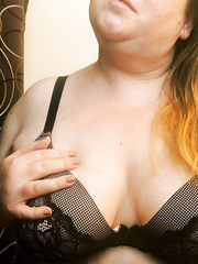 big beautiful woman Sarah showing her curves and displaying a chubby snatch