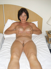 Older lady posing in the hotel room in advance of fucking with freind pair