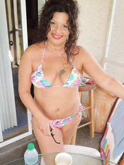 Large tit mother i'd like to fuck showing off her bikinis