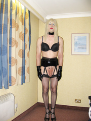 PVC Fetish Slut PatsyPVC showing cock, dressed in a PVC  Shiny Suspender Belt, Shiny Nylon Stockings and 6 inch shiny high heels ready to suck off cock
