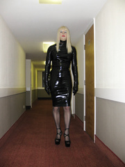 PatsyPVC Shiny Fetish Slut Erect Cock and Butt Plugged Transvestite Dressed in a Women's PVC Dress, Seamed Stockings ,PVC Suspender Belt and 6 inch High Heels..!
