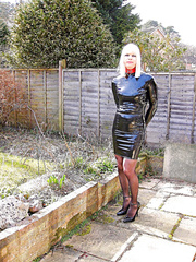 PatsyPVC Fetish Transvestite Slut photographed Outdoors by neighbours Dressed in Woman's PVC Dress, Seamed Stockings and 6 inch High Heels
