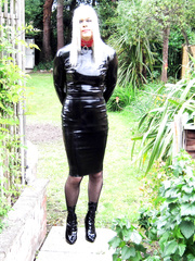 PatsyPVC Sissy PVC Fetish Transvestite Slut Exposed Dressed in a Womens Shiny PVC Dress, Shiny PVC Suspender Belt, nylon stockings and High Heels with all the neighbours out watching