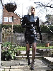 PatsyPVC Sissy Fetish Slut Transvestite Dressed in a Womens Shiny PVC Dress, Shiny PVC Suspender belt, Stockings, High Heels Walking Outdoors with a Fully Inflated Extra Large Anal Butt Plug Filling up my Arse with all the Neighbours Watching