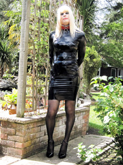 PatsyPVC Latex Sissy Cock Sucking Fetish Anal Slut Maid Transvestite Outdoors with all Neighbours watching.... Dressed in a Women's Shiny Latex Rubber Fetish Slut Dress, Shiny PVC Suspender belt, Shiny Stockings and High Heels and Arse PLUGGED with an EXT