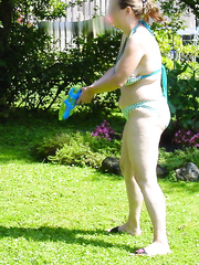 My sexy sister in-law showing off her chubby body and doing her chores