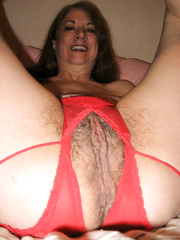 Sexy hairy Julie in her red lingerie spreading and posing