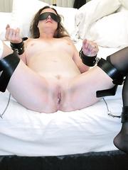 Bondage babe awaits cock insertion restrained on bed waiting