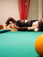 A slutty swinger wife having adult fun on a pool tale with sex toys