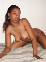 A stunning black friend posing on my bed naked for you