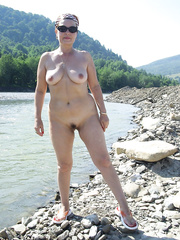 MILF naked outdoor enjoying the sun by the river