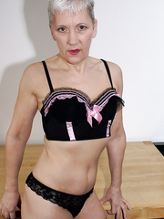 GILF stripping off new underwear and showing all to you