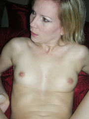 A stunning blond wife posing in all her glory naked on the bed