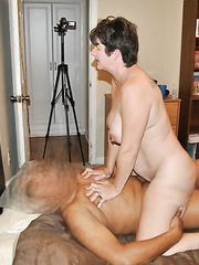 Mature fucked from behind by black stud while hubby takes adult pics