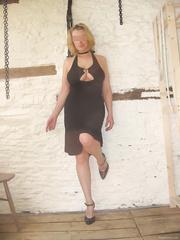 Wearing then not wearing a black dress tied up in bondage gear