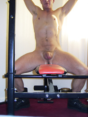 Me naked in boots on my weight bench working out home gym