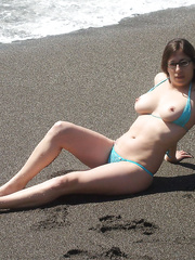 A sexy slut posing for you inside and out side flashing her bits