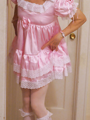 Shirley's sissy photos lifting up frilly dress to reveal chastity cock