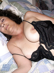 Lusy Wears a Black Piece of Lingerie While on the Bed
