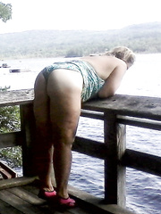 Shy wife posing for amateur photos outdoors in public