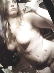 caitie self-shots with chocolate syrup smeared across nude body