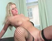 Girl in dark fishnets rides a dark penis