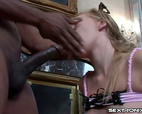 Skinny youthful golden-haired sucks a large dark rod