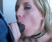 Girl in sparkly collar sucks large dark jock