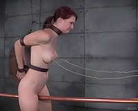 Poor redhead girl goes forward and backwards and suffers
