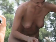 Spy camera filming a slim old milf with her nude body and miniature billibongs