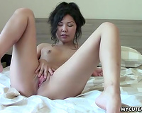 Small tittied Chinese nympho finger bonks her twat with excitement