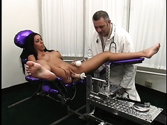 Long haired brunette hair receives her anal opening worked over by a fucking machine