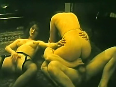 Retro porn scene with 2 excited brunettes sharing one dick in trio