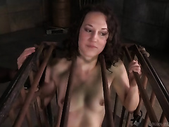 Flat chested slave hotwife sits in the cage and waits for tortures