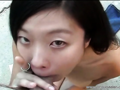Slutty Chinese nympho is engulfing her fuck buddy's meat stick by the pool